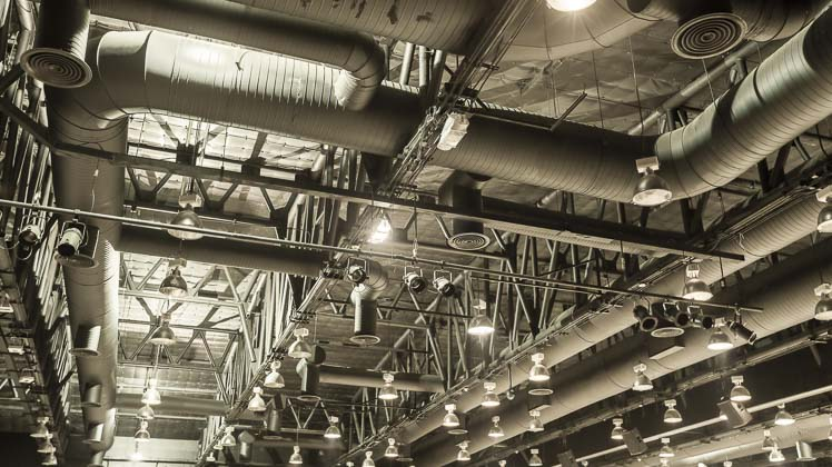 Photo of industrial facility ceiling showing ventilation and lighting